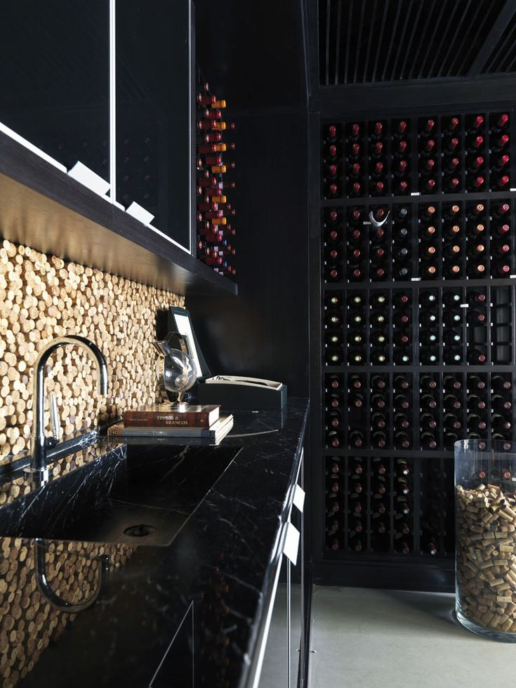 Love wine and need something to do with those corks. Check out this Cork Back-splash in wine cellar. #Wine #Cellar