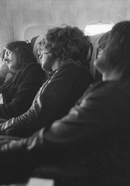 John Bonham, Robert Plant and John Paul Jones asleep on plane during US tour, 1969.