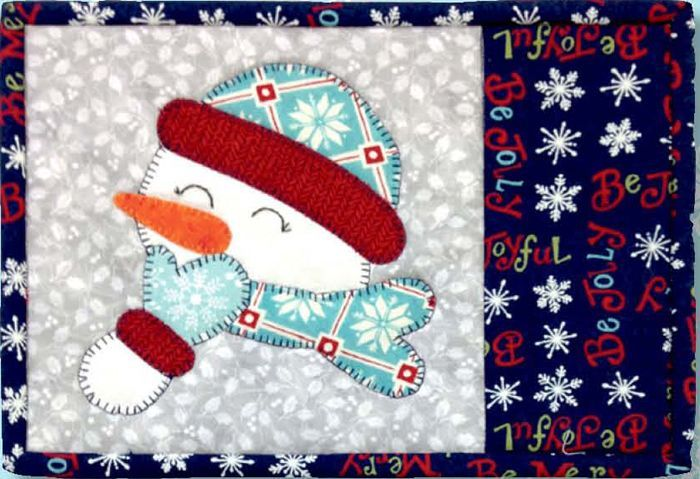 Applique mug rug for Winter. Joyful Snowman Mug Rug Pattern G2P-128 by Going 2 Pieces Quilts - Ruthann Benge. Check out our Winter patterns. https://www.pinterest.com/quiltwomancom/winter-patterns/ Subscribe to our mailing list for updates on new patterns and sales! https://visitor.constantcontact.com/manage/optin?v=001nInsvTYVCuDEFMt6NnF5AZm5OdNtzij2ua4k-qgFIzX6B22GyGeBWSrTG2Of_W0RDlB-QaVpNqTrhbz9y39jbLrD2dlEPkoHf_P3E6E5nBNVQNAEUs-xVA%3D%3D