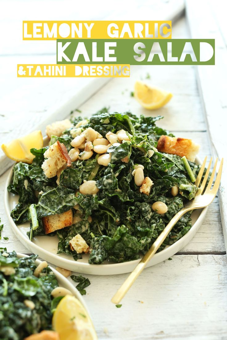 AMAZING Lemony Garlic Kale Salad with Butter Beans and Garlic Croutons. The Garlic-Tahini Dressing makes it! #healthy #recipe