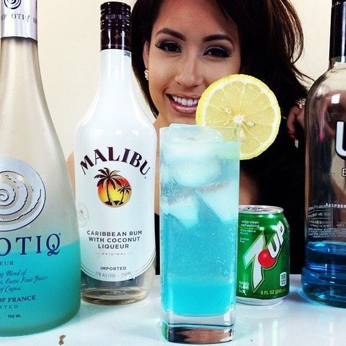 Electric Beach Water  1 oz. (30ml) UV Blue Vodka 1 oz. (30ml) Malibu Rum 1/2 oz. (15ml) Hpnotiq 1/2 oz. (15ml) Lemon Juice Top with Sprite/7up