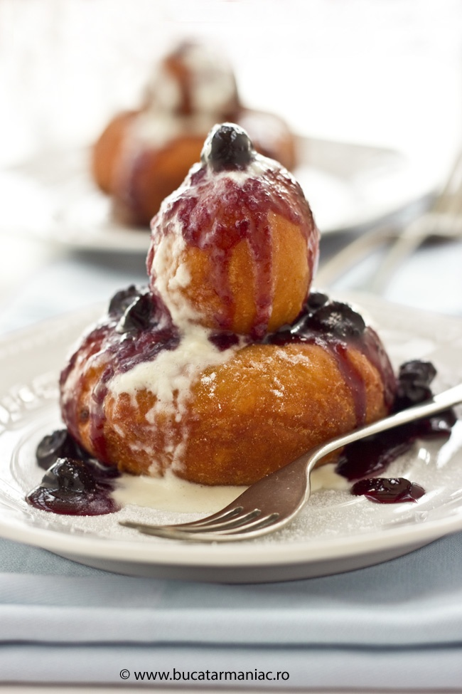 Deep fried cheese doughnuts with fruit preserves and cream. The recipe is in Romanian but this is a delicious dish worth using google translate.!