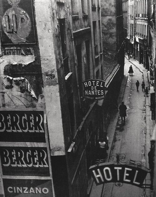 Rue Quincampoix Paris ca. 1932 Photo: Brassai. The perspective of this image…