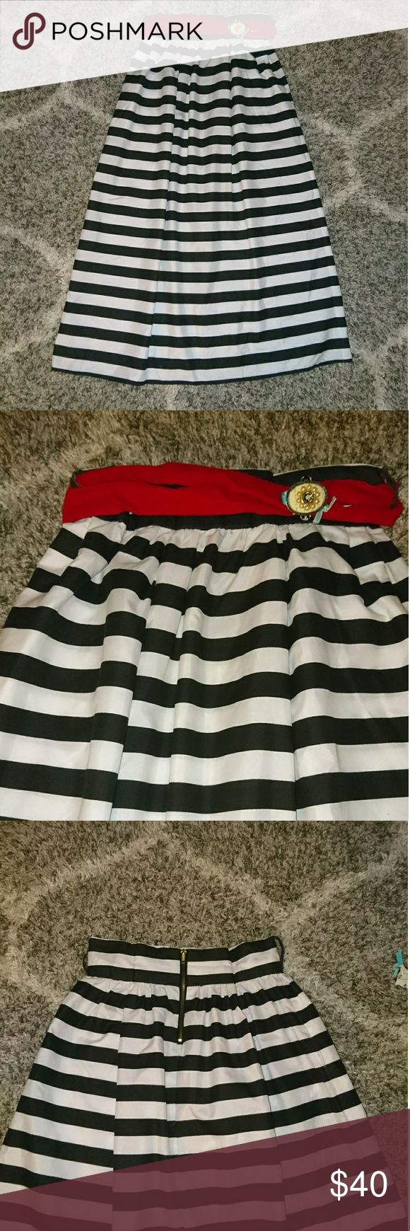 Semi formal black and white striped maxi skirt Homemade. Made this several years ago with a lady who could sew much better than me☺️. Gathered. Has pockets😁! I wore this similar to the pics with a black top for Christmas parties and a nice green tank blouse with sandals for the summer 😊. The material has a slight sheen to it. I cannot remember the fabric content but I have steam cleaned and ironed it with no problems. I will include the wired, velvet like material red sash. It is long…