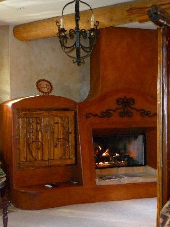 Adobe fireplace next to bed