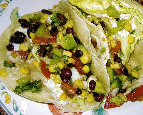 Southwestern Soft Tacos recipe. Fill a tortilla with all this great food - it looks delicious! Nice meal for lunch or a light supper year-round.  Yum!