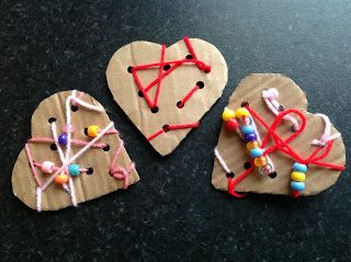 Valentine Hearts = Stitch up some refrigerator magnets -- Punch card board hearts; decorate with yarn stitches & beads.