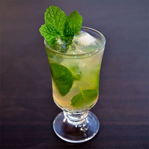 Lucid Frappe:  1 oz Lucid Absinthe  .5 oz Simple syrup (one part sugar, one part water)  6-8 Fresh mint leaves  1 oz Club soda  Garnish: Mint sprig  Glass: Frappe