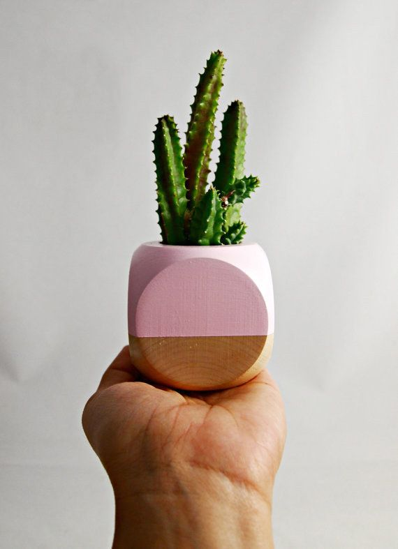 A tiny little plant pot that you could put a tiny little cactus in. | 26 Office Accessories That Will Make You Happier To Be At Work