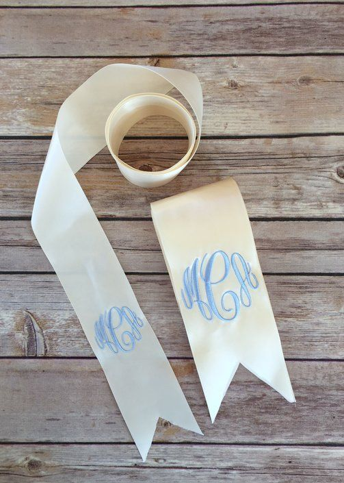 We think our bouquet ribbons are the perfect marriage of simplicity and elegance! Available in Ivory or White satin ribbon, your sash will be personalized with your initials or monogram.