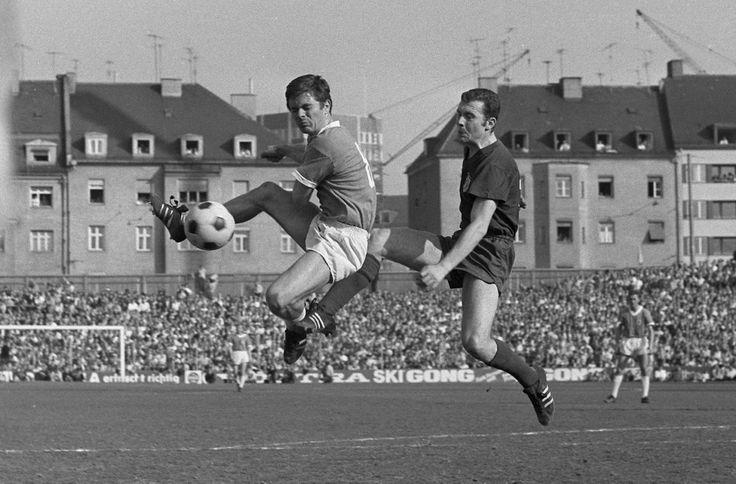 Franz Beckenbauer of Bayern München in action against Wilfred Kohlars of TSV 1860 München, Stadion Grünwalder Straße, middle 1960s