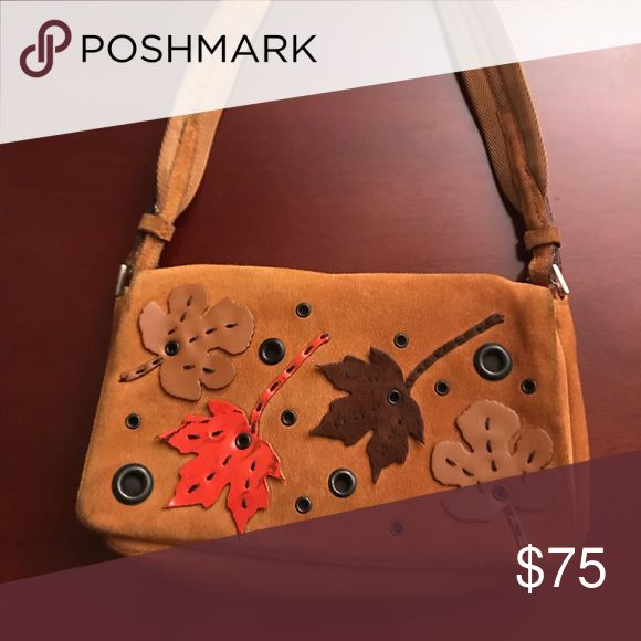 Shop Women s Prada Tan size OS Shoulder Bags at a discounted price at  Poshmark. Description  Prada suede camel color handbag with leaf motif. 9a86cb19cf