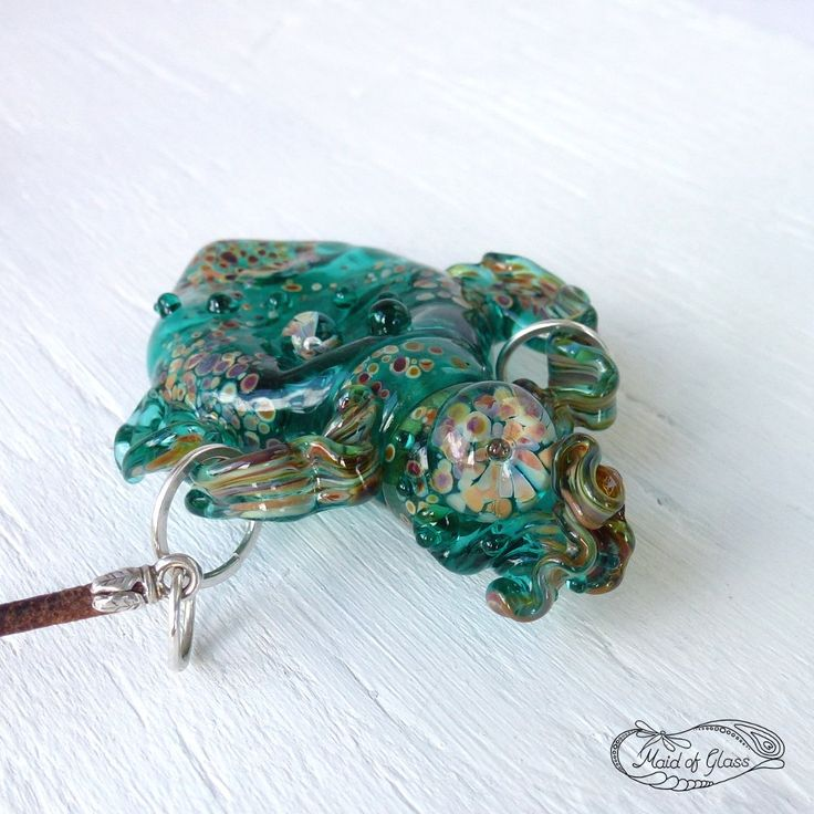A personal favourite from my Etsy shop https://www.etsy.com/uk/listing/457739438/teal-green-little-lampwork-glass-bottle