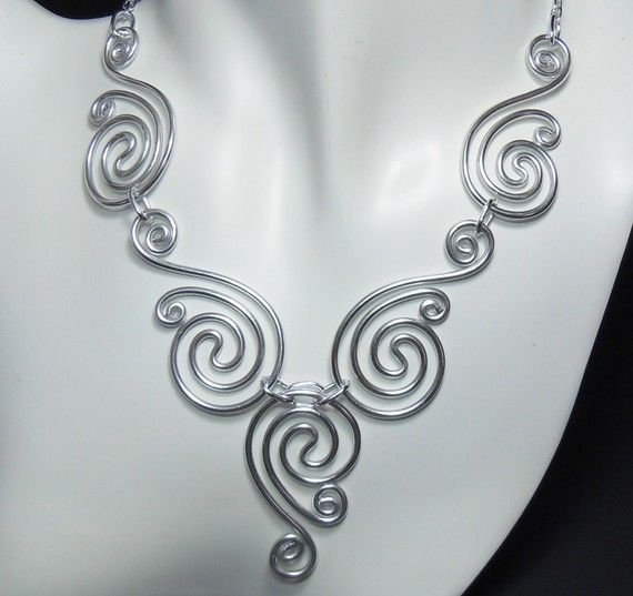 Aluminium spirals necklace. I don't like the idea that it is made from aluminium, seems an odd medium to work with and has it has a tendency to tarnish and not in a nice way like copper, it definitely wouldn't be something I would try.