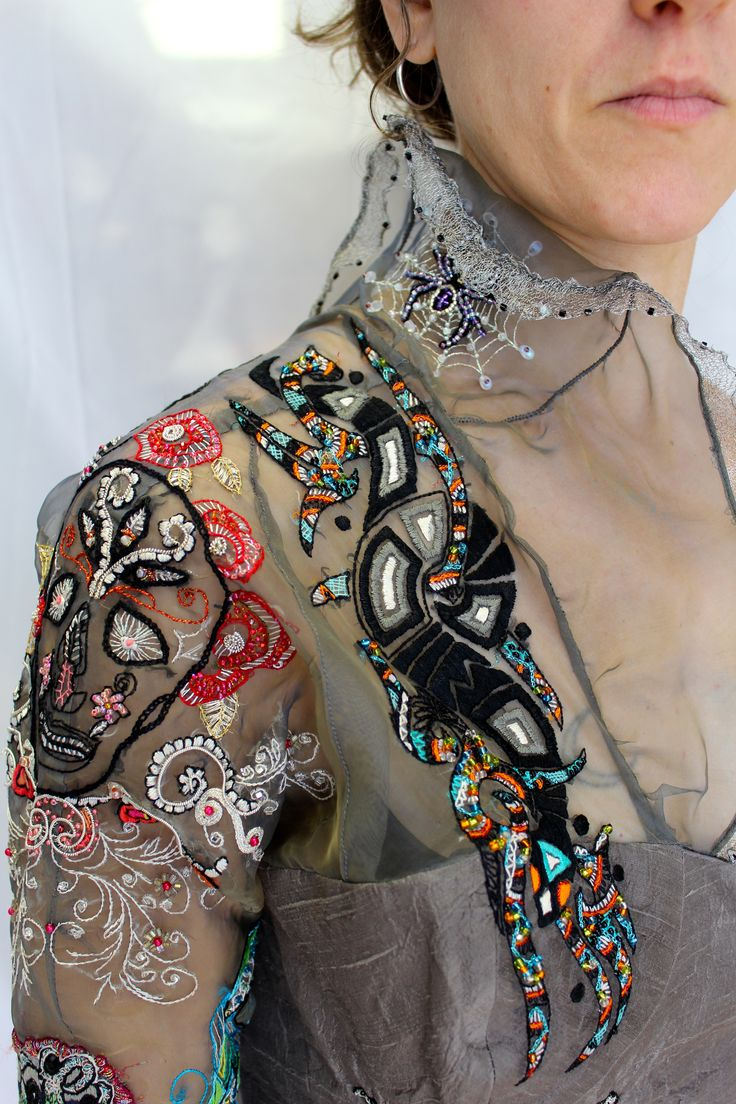 Abrash embroidery - Detail of my 'Tattoo-inspired' sleeve. It's a corset with all of my favorite tattoo art beaed and embroidered onto it.