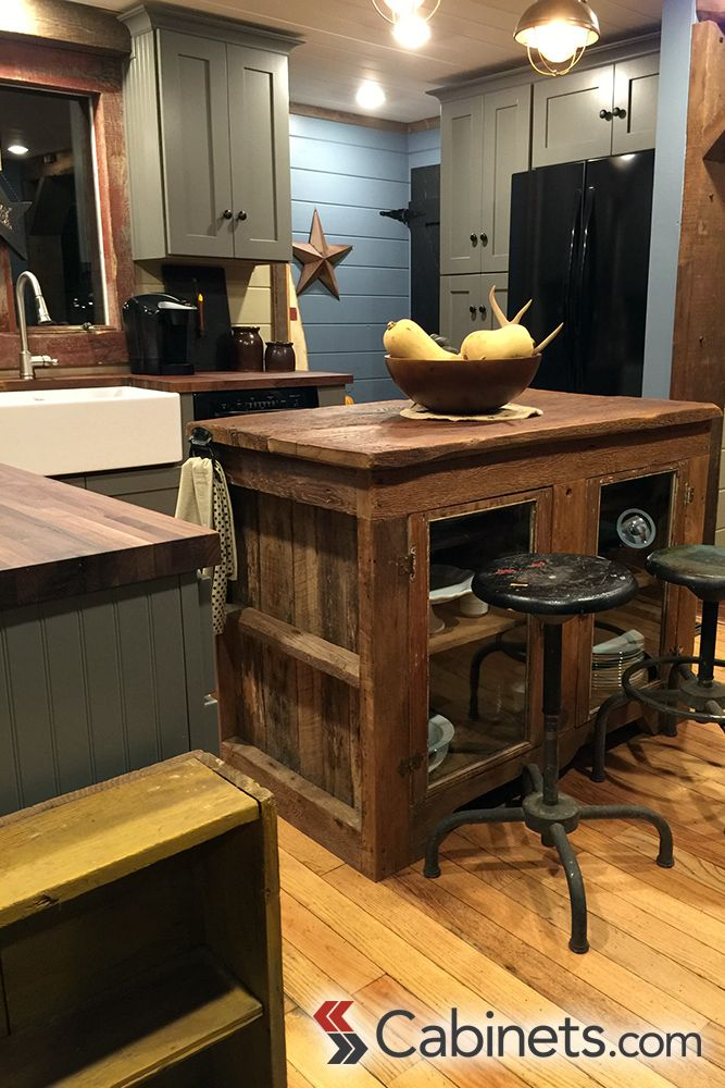 A kitchen island made from reclaimed wood is the perfect touch to this rustic kitchen!