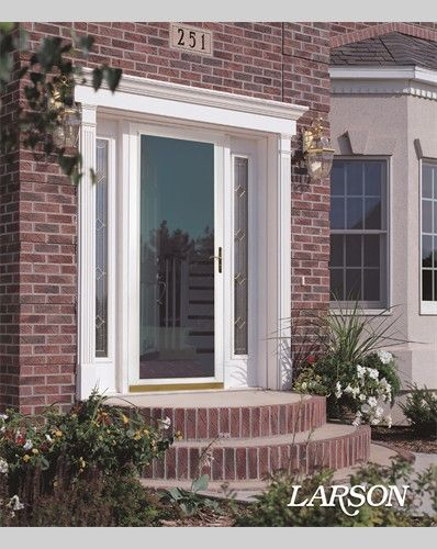 Traditional entrance with a larson white storm door lets for White storm door