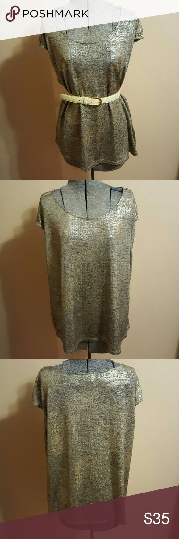 Calvin Klein Gold Top Calvin Klein sparkly gold and silver short-sleeved top. Silky and stretchy with button detailing on the shoulders. Perfect condition. Belt not included. Calvin Klein Tops