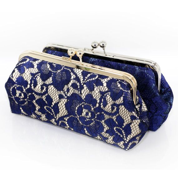 The bridal bag is made of satin in champagne and wrapped around with a layer of peony floral lace in navy blue. This elegant floral clutch would be the perfect accouterment to the bridal party in navy blue and to the mothers of the bride and groom wearing a dark blue or black dress. This lining (inside) of this clutch bag can be personalized with a photo that you send us, please choose the option from the pull down menu.  Base Fabric: Satin in Champagne Overlay: Peony Floral lace in navy…