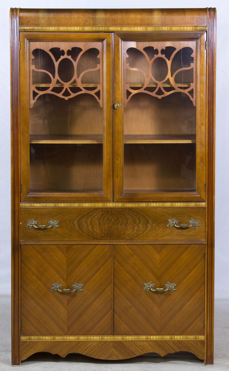 Lot 60 Mahogany Veneer Waterfall China Cabinet c1940 having double wood frame glass doors