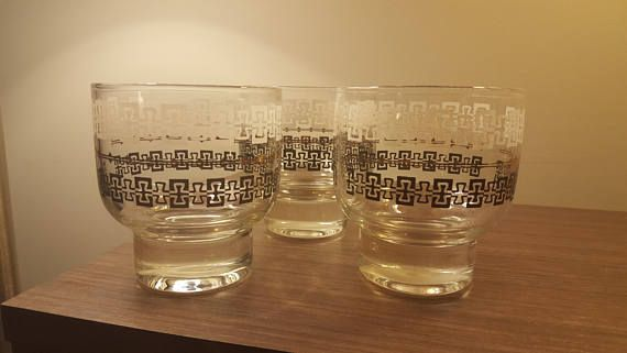 Check out this item in my Etsy shop https://www.etsy.com/ca/listing/560547088/vintage-scotch-glass-set-gold-cup-retro