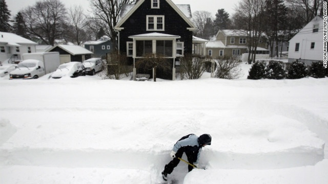 Mary Leahy shovels her sidewalk in Medford, Massachusetts, on Saturday, February 9. A massive blizzard that dumped as much as 3 feet of snow in some parts of the Northeast is heading out to sea, as workers across New York and New England struggle to get airports, trains and highways back online.