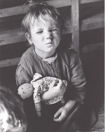 David Seymour, A displaced child from the Sudeten Lands plays with homemade doll, Austria, 1948