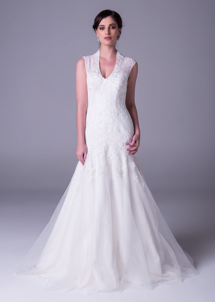 Look a little closer. This magnificent #weddingdress is #bridal #elegance at it's finest, with #exquisite #lace detailing and Queen Ann neckline - a high rising collar at the back of the neckline with buttons extending down the #weddinggown. Style MS251005. Click to book a free fitting in this #weddinggown #laceweddingdress
