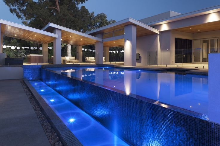Luxurious custom pool with infinity edge design by Pools by Design