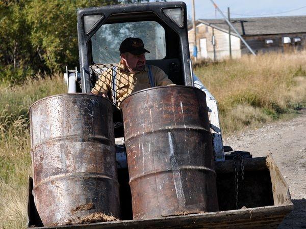 The Hutterites Ben Hofer transporting fat for the soap.