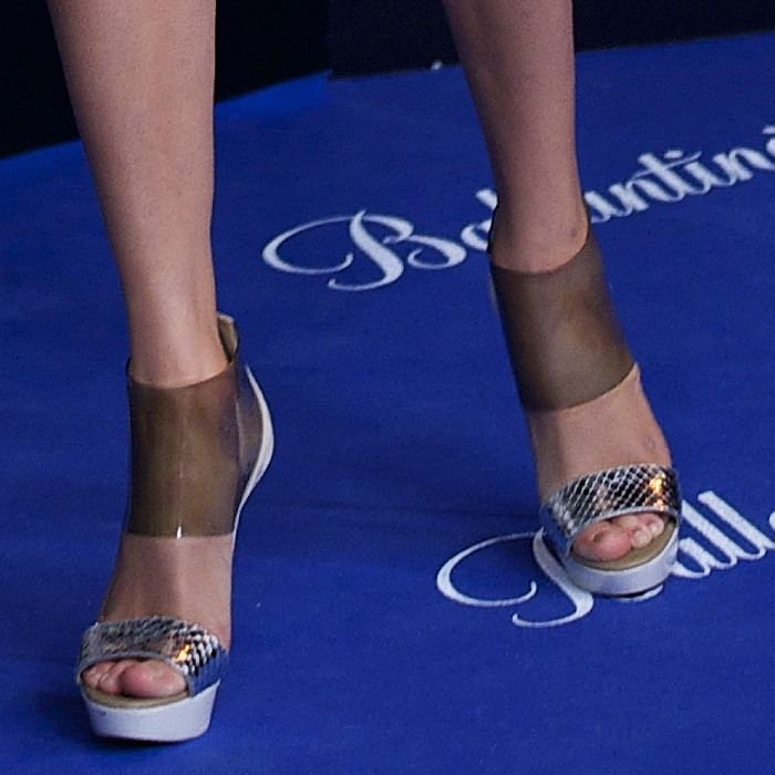 Taylor Swift in snake-print and transparent PVC platform sandals from Christian Louboutin's Spring 2013 collection
