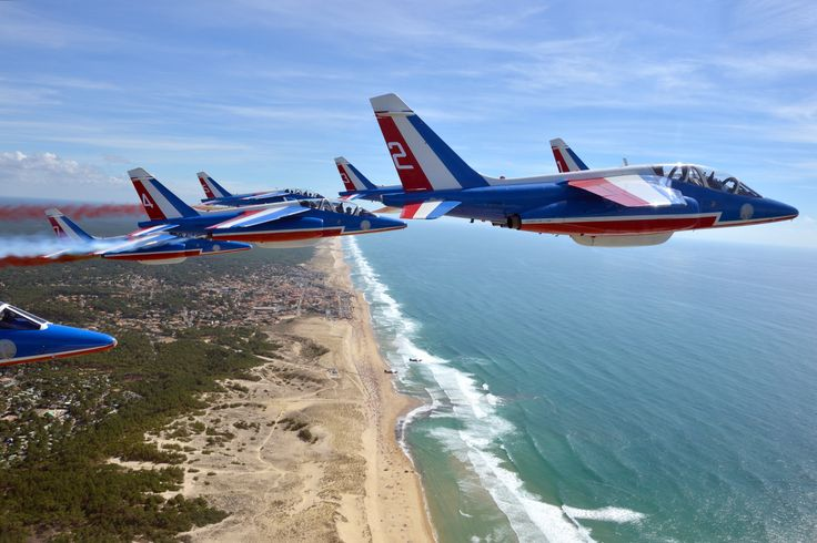 Dassault Alpha Jets of the Patrouille de France in flight over Plage Centrale, near Lacanau, on the Bay of Biscay, August 2016. (Photo: Patrouille de France)