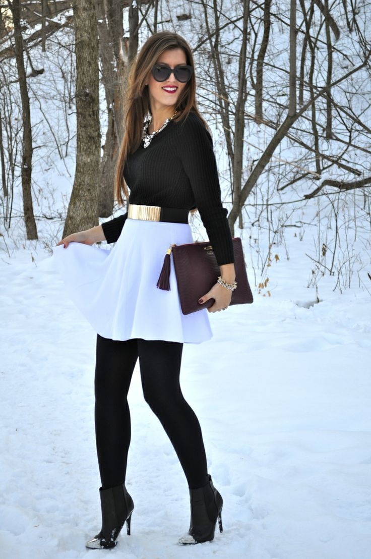 Marry a black crew-neck pullover with a white skater skirt to create a great weekend-ready look. A cool pair of black leather ankle boots is an easy way to upgrade your look.  Shop this look for $91:  http://lookastic.com/women/looks/sunglasses-necklace-crew-neck-sweater-belt-bracelet-clutch-skater-skirt-tights-ankle-boots/7177  — Black Sunglasses  — Silver Necklace  — Black Crew-neck Sweater  — Gold Belt  — Silver Statement Bracelet  — Dark Purple Leather Clutch  — White Skater Skirt  — ...