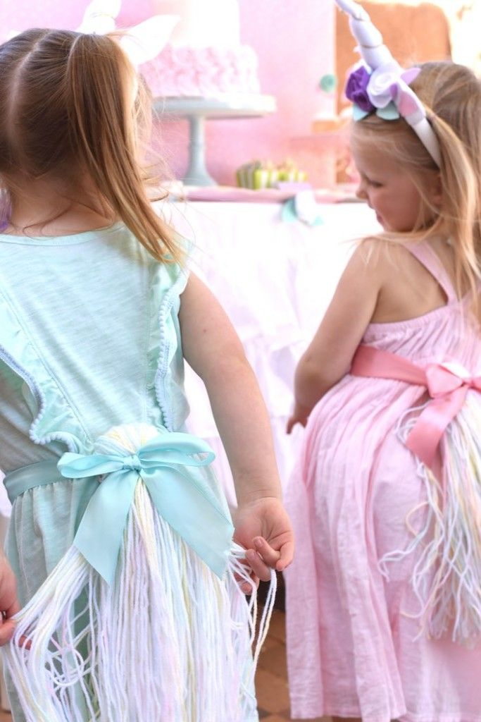 Unicorn tails waving at a Pastel Unicorn Themed Birthday Party via Kara's Party Ideas | KarasPartyIdeas.com (7)
