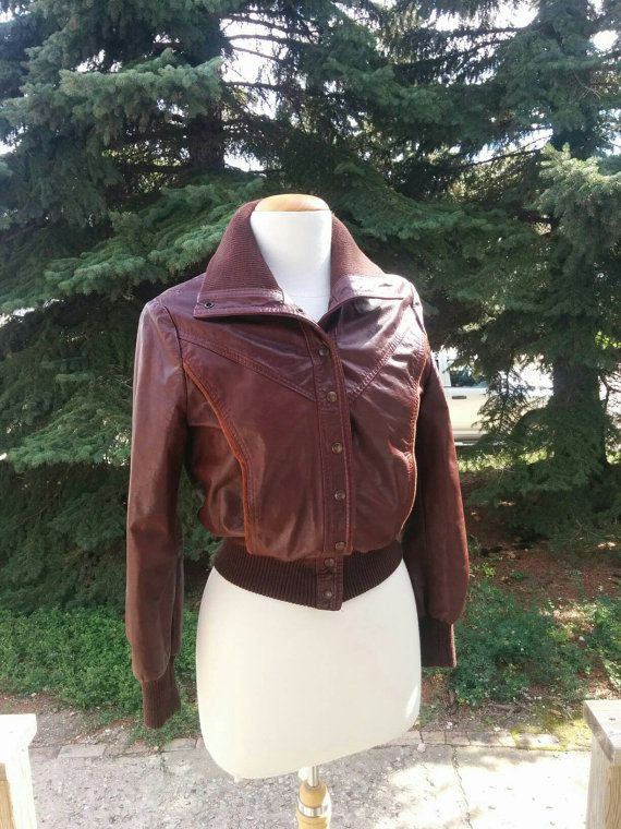 Check out this item in my Etsy shop https://www.etsy.com/listing/475179645/vintage-1970s-burgandy-leather-bomber