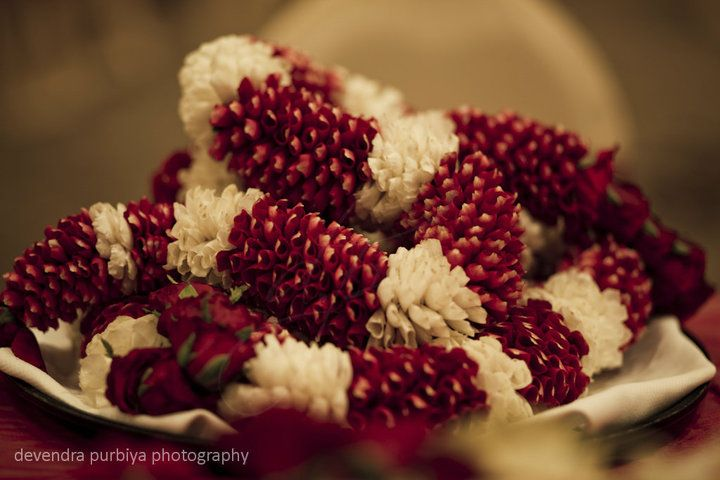 The Jaimala - Garlands , exchanged between an Indian Bride and Groom at their wedding. It's a prelude to the main wedding ceremony. Photo- Dev's Photography