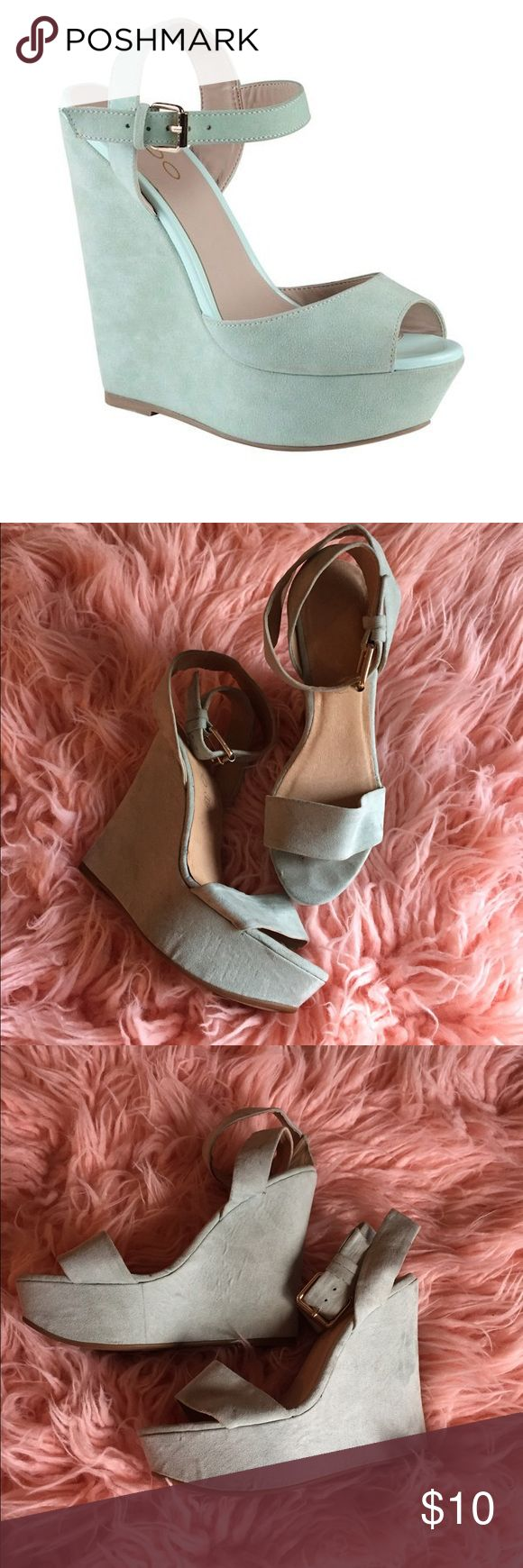 Aldo Cybil Mint Wedge Platform Heels Material: Suede. Sole: Rubber. These playful wedges are both comfortable and trendy. Wedge platform. Ankle strap. Peep toe. Heel height: 5.25 In. Platform height: 1.5 In. Worn a few times. No box. Aldo Shoes