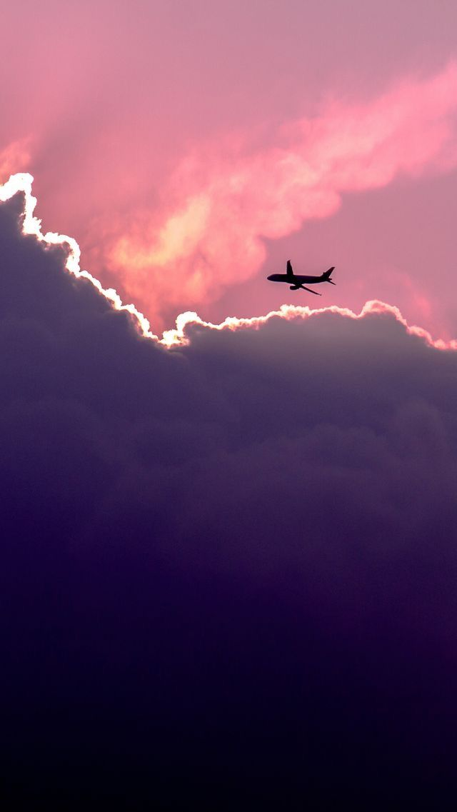 Airplane and purple skies