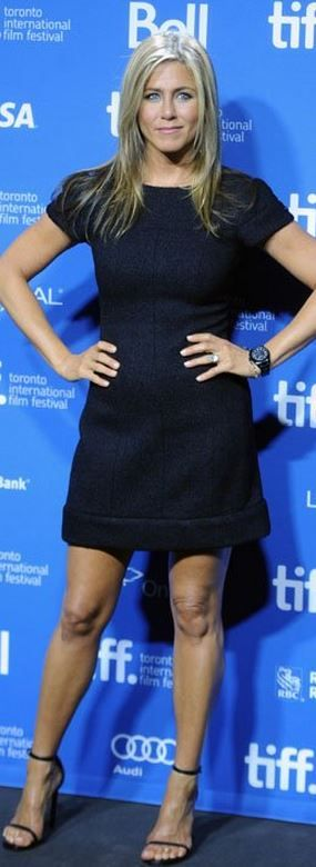 Who made  Jennifer Aniston's navy blue short sleeve dress and black ankle strap sandals that she wore in Toronto?