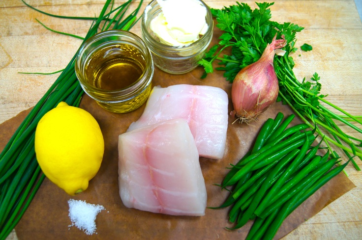 Halibut Ingredients:  6 oz piece of halibut  handful of blanched French Bean  1 tbsp butter  1/2 shallot finely diced  1/2 a lemon cut in half  fresh herbs (parsley, chives)  grape seed oil  salt