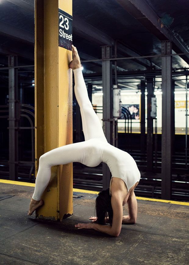 "Slovenia native Anja Humljan turns spaces like subway platforms, grocery store aisles and basketball courts into studios for reflection and balance. She created The Urban Yoga Photo Book to help people feel connected to their environments. ""As far as the poses are concerned, my aim was to connect, intertwine and mimic the urban space,"" she says on her website"