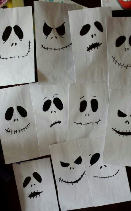 I bought plain white bags at the party store and drew on the mamy faces of Jack with a sharpie.  Nightmare before Christmas goodie bags #nightmarebeforechristmas: