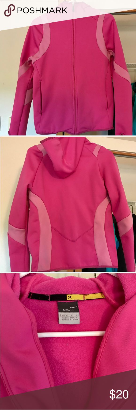 Nike pink zip up Used a few times, lots of life left Nike pink thermal fit zip up with hood. Has zipper pockets in front and thumb holes in sleeve. Size M but feels like a S to me. Nike Sweaters