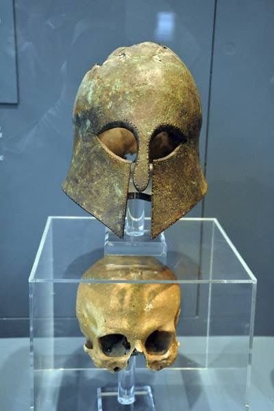 Corinthian helmet from the Battle of Marathon (490 BC) found with the warrior's skull inside.  http://www.ancienthellas.eu/2017/04/a-corinthian-helmet-from-battle-of.html
