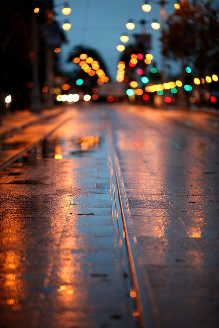 Wet tracks - By Thomas Hawk, via Flickr / / Bokeh / After the rain / Night city lights