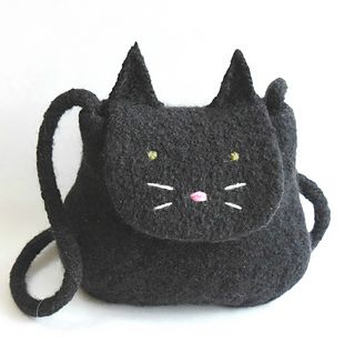 A fun purse for cat lovers, this is a 2 to 3 day advanced beginner project. It's knit in the round, then felted in a washing machine. The face is accomplished with a few simple yarn stitches after felting.
