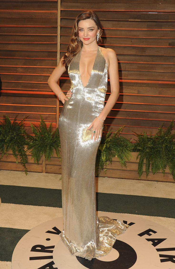 Miranda Kerr likely got herself mistaken for an Oscar statuette in this long and lean Kaufman Franco metallic column gown. And while the model would look gorgeous even in a turtleneck, the neckline on this one kept the heat level high. Her sparkle came courtesy of a Jacob & Co. ring and bracelet.