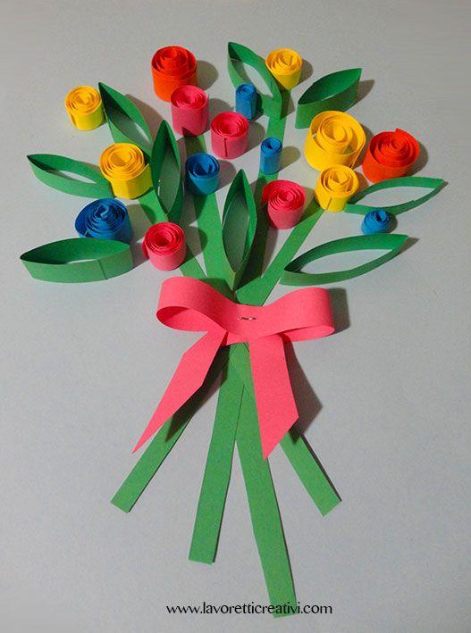 Bouquet di fiori di carta da regalare alla mamma per il giorno della sua festa. Il lavoretto è realizzato con striscioline di carta arrotolate. Quil