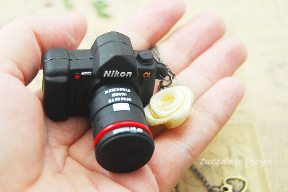 Hey, I found this really awesome Etsy listing at https://www.etsy.com/listing/108289979/8gb-usb-flash-drive-a-mini-dslr-camera  Coolest idea ever!