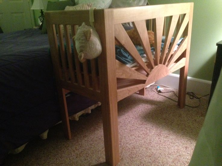 Co-sleeper. A rising sun co sleeper that attaches to the side of a bed